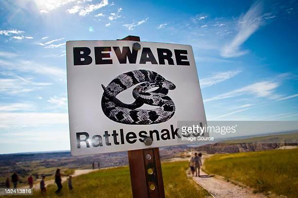 Beware Rattesnakes! Sign in Badlands National Park, South Dakota, USA