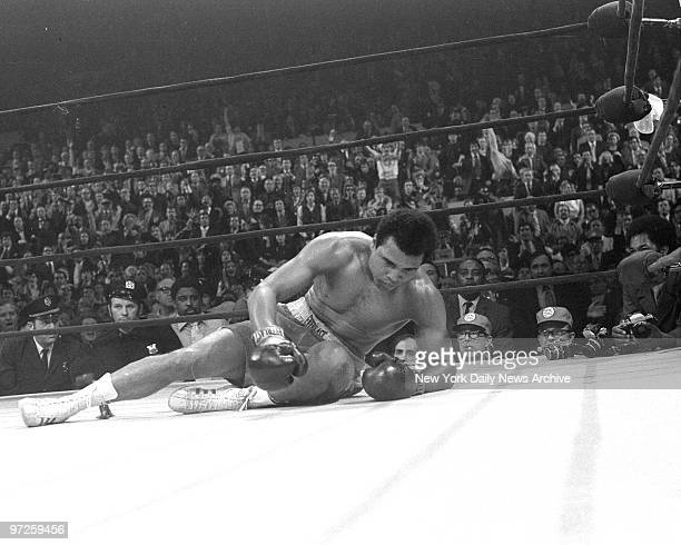 Bewildered dazed hurt and beaten Muhammad Ali struggles to get back on his feet in punishing 15th round knockdown by Joe Frazier