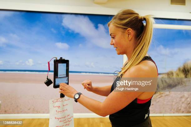 Bex Rowe, Health Club Manager of the St Michael's Health Club, undertakes an online fitness class in an empty studio during the final days of the...