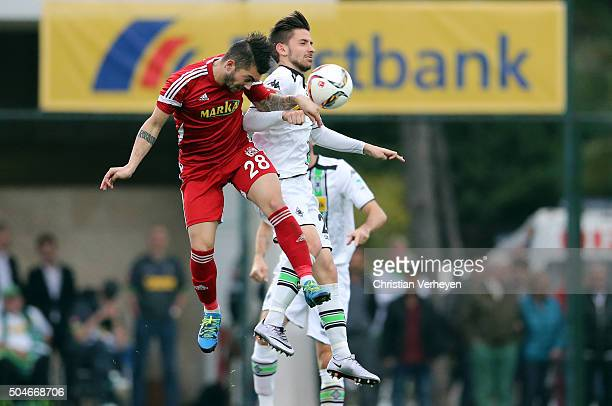 Beykan Simsek of Medicana Sivasspor and Julian Korb of Borussia Moenchengladbach #bfb during a friendly match between Borussia Moenchengladbach and...