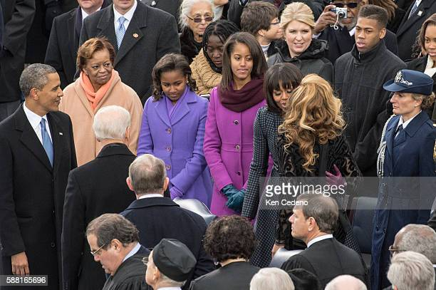 Beyoncé receives a kiss from the First Lady Michelle Obama after she sang the National Anthem at the closing of the 57th Presidential Inaugural...