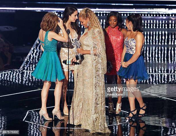 Beyonce accepts her award from Olympic gymnasts Madison Kocian Aly Raisman Simone Biles and Laurie Hernandez onstage during the 2016 MTV Video Music...