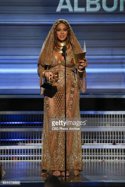 Beyonce accepts the Grammy Award for Best Urban Contemporary Album during THE 59TH ANNUAL GRAMMY AWARDS broadcast live from the STAPLES Center in Los...