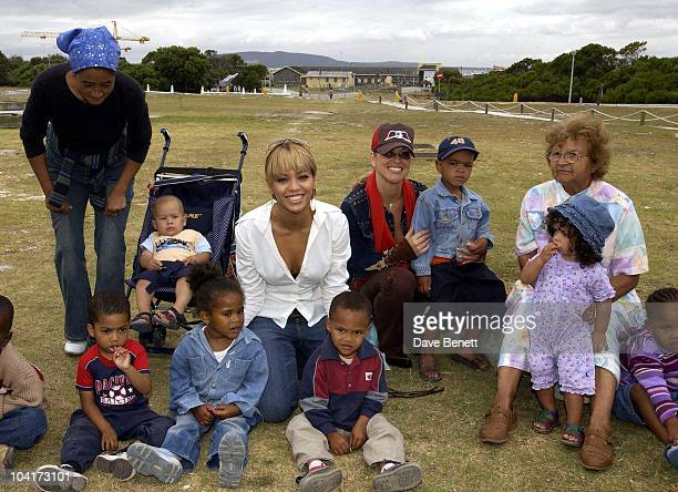 Beyonce And Anastasia With Local Children The Stars Of Rock And Roll Join Forces For Nelson Mandela's 46664 Concert In Cape Town South Africa In The...