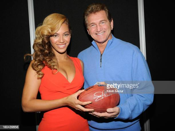 Beyonce and former NFL player Joe Theismann pose backstage at the Pepsi Super Bowl XLVII Halftime Show Press Conference at the Ernest N. Morial...