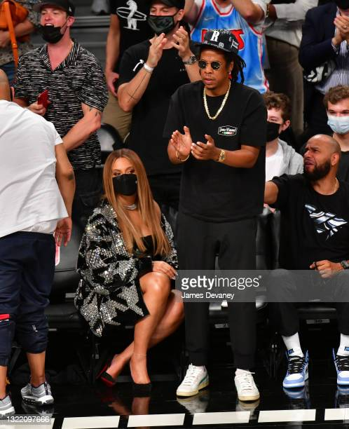 Beyonce and Jay-Z attend Brooklyn Nets v Milwaukee Bucks game at Barclays Center of Brooklyn on June 05, 2021 in New York City.