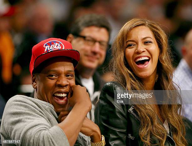 Beyonce and JayZ attend Game Six of the Eastern Conference Quarterfinals during the 2014 NBA Playoffs at the Barclays Center on May 2 2014 in the...