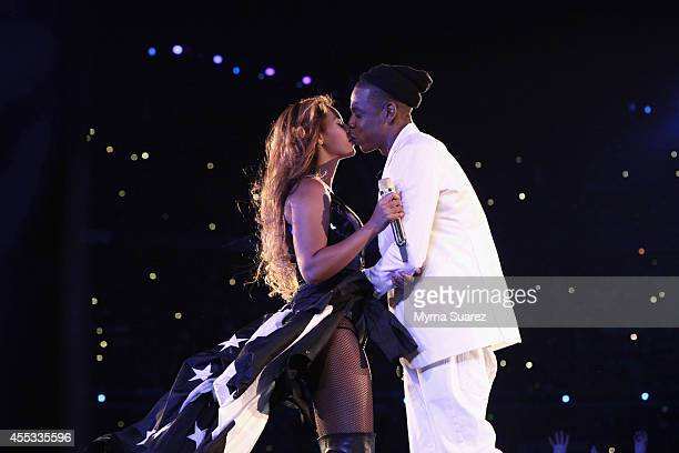 Beyonce and JayZ kiss during the 'On The Run Tour Beyonce And JayZ' at the Stade de France on September 12 2014 in Paris France