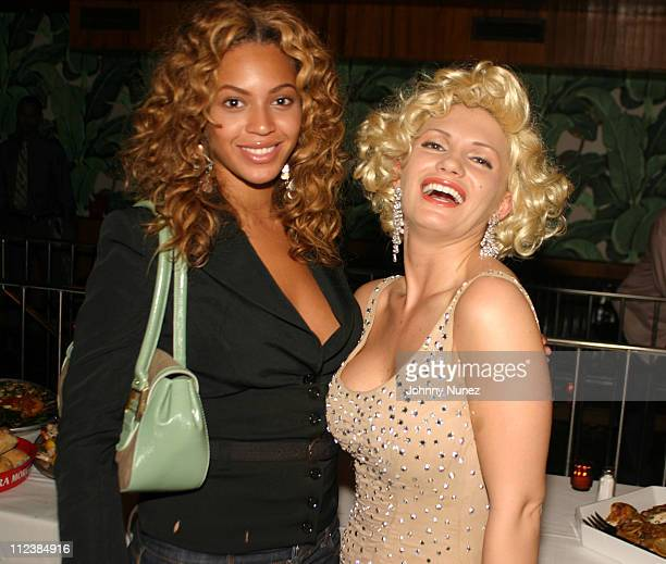 Beyonce and Marilyn Monroe Impersonator during Damon Dash's Birthday Party May 4 2004 at La Bodega in New York City New York United States