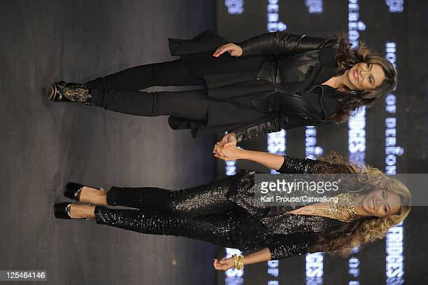 Beyonce and mother Tina Knowles walk the runway at the end of their fashion runway presentation for House of Dereon during London Fashion Week on...