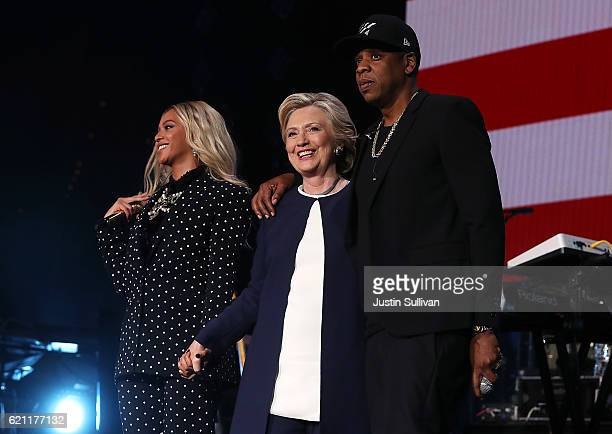 Beyonce Democratic presidential nominee former Secretary of State Hillary Clinton and Jay Z appear on stage during a Get Out The Vote concert at...