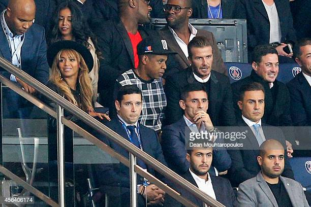 Beyonce JayZ and David Beckham watch the action during the Group F UEFA Champions League match between Paris SaintGermain v FC Barcelona held at Parc...