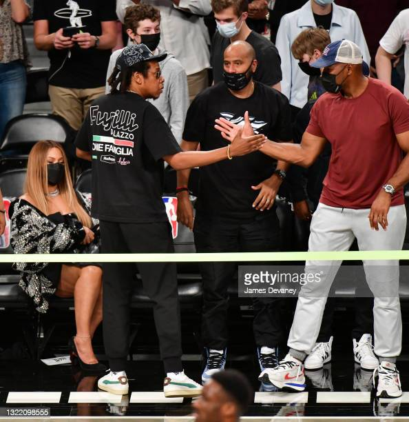 Beyonce, Jay-Z, guest and Michael Strahan attend Brooklyn Nets v Milwaukee Bucks game at Barclays Center of Brooklyn on June 05, 2021 in New York...