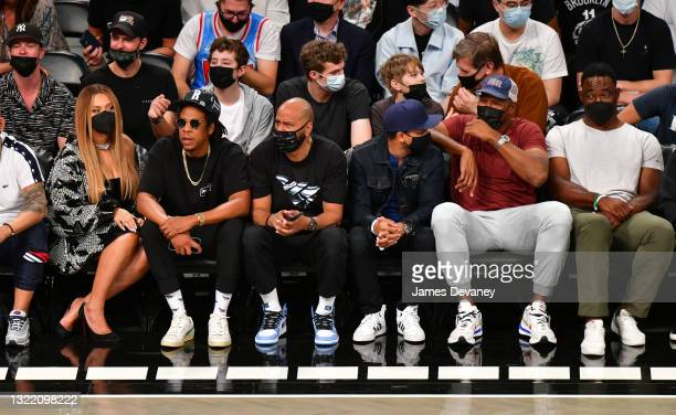 Beyonce, Jay-Z, guests, Michael Strahan and Justin Tuck attend Brooklyn Nets v Milwaukee Bucks game at Barclays Center of Brooklyn on June 05, 2021...