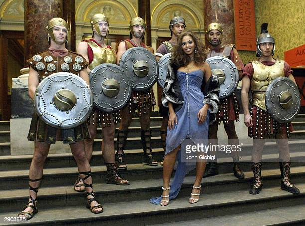 Beyonce Knolwes poses with some Gladiators for the cameras during the Premiere for the new Pepsi Music Commercial 'Pepsi Gladiators' at the National...