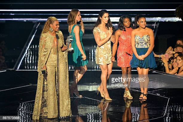 Beyonce Knowles accepts an award from US Olympic gymanstic team at the 2016 MTV Music Video Awards at Madison Square Garden on August 28 2016 in New...