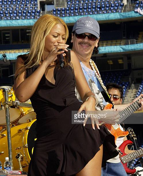 Beyonce Knowles and Carlos Santana during Super Bowl XXXVII PreGame Show Rehearsal at Qualcomm Stadium in San Diego California United States