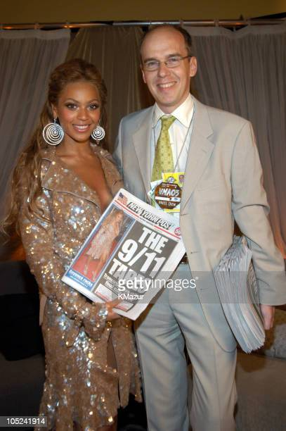 Beyonce Knowles and David Boyle pose with the cover of the New York Post featuring Beyonce
