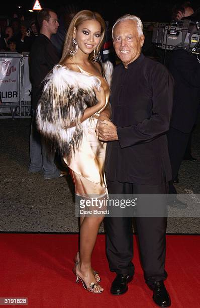 Beyonce Knowles and Giorgio Armani attend Fashion Rocks for the Prince's Trust at the Royal Albert Hall on October 15 2003 in London The event...