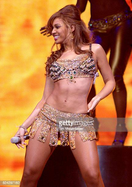 Beyonce Knowles and her dancers perform on stage as part of the Verizon Ladies First Tour 2004 at the Oakland Arena