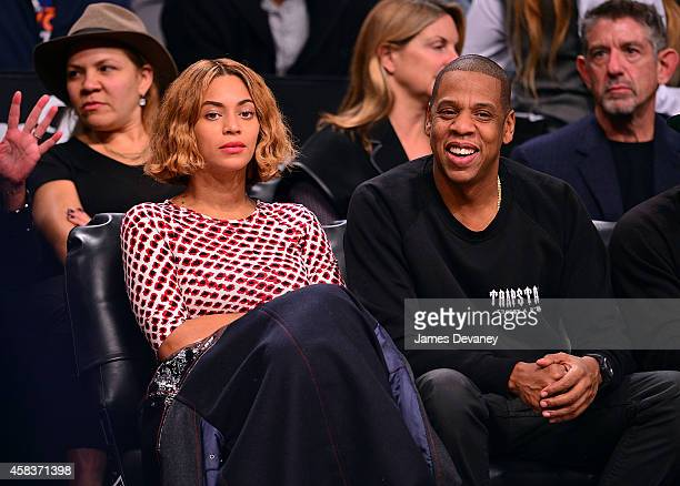 Beyonce Knowles and JayZ attend the Oklahoma City Thunder vs Brooklyn Nets game at Barclays Center on November 3 2014 in the Brooklyn borough of New...