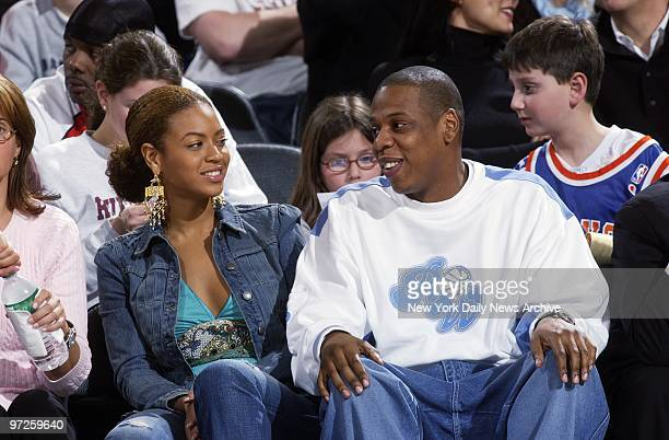 Beyonce Knowles and JayZ chat during game between the New York Knicks and the New Jersey Nets at Madison Square Garden The Nets trounced the Knicks...