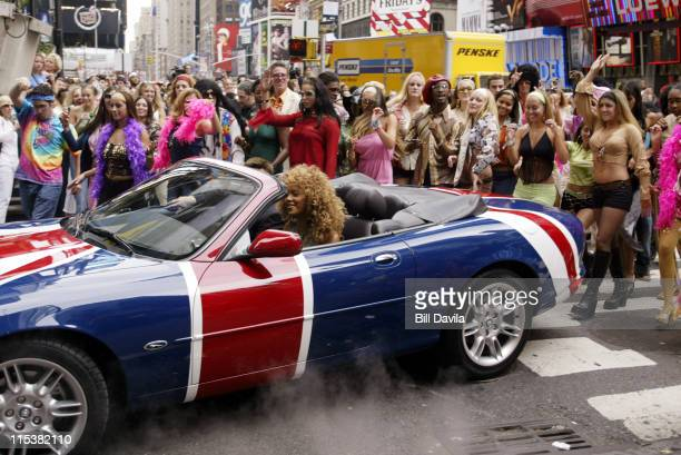 Beyonce Knowles drives Austin Powers' car during Mike Myers and Beyonce Knowles Promote 'Austin Powers in Goldmember' on MTV's TRL at Times Square in...
