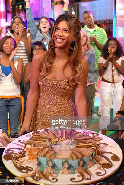 Beyonce Knowles is presented with birthday cake at MTV Studios