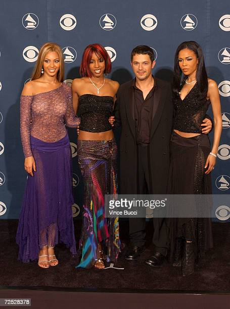 Beyonce Knowles Kelly Rowland and Michelle Williams of Destinys Child pose with Alejandro Sanz backstage during the 44th Annual Grammy Awards at...