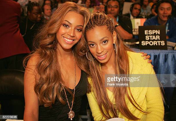 Beyonce Knowles of Destiny's Child and her sister Solange Knowles pose together at the 2005 NBA All Star Game at the Pepsi Center on February 20 2005...
