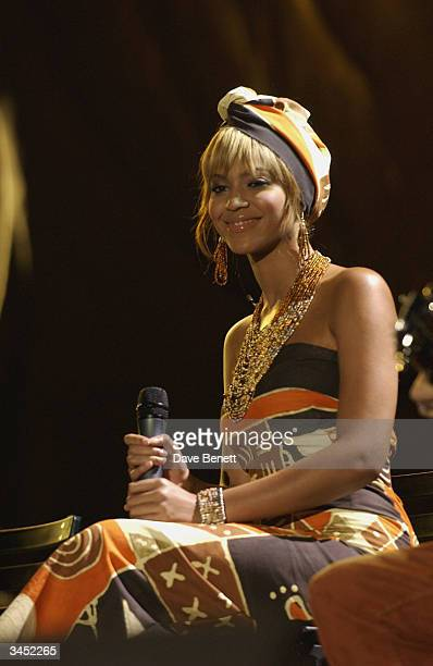 Beyonce Knowles performs at The Nelson Mandela Foundation's 46664 Give One minute to Aids Concert at The Greenpoint Stadium on November 29 2003 in...