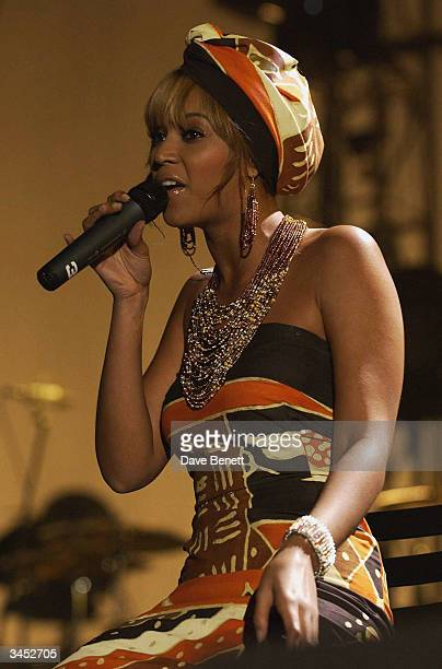 Beyonce Knowles performs at The Nelson Mandela Foundation's '46664 Give One minute to Aids' Concert at The Greenpoint Stadium on November 29 2003 in...