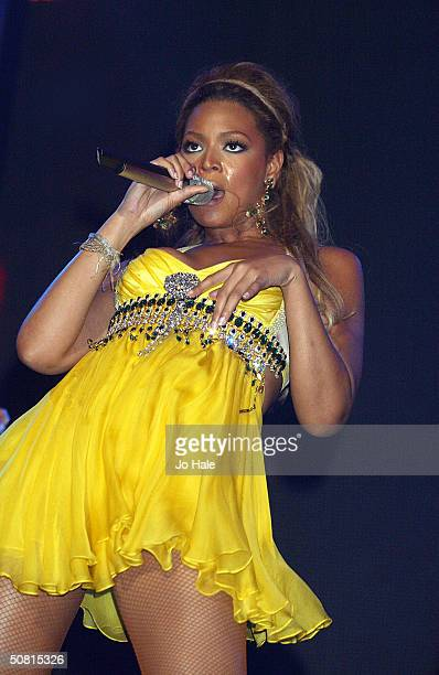 Beyonce Knowles performs on stage during the first day of the 'The Prince's Trust Urban Music Festival' at Earls Court May 8 2004 in London The...
