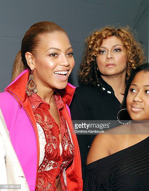 Beyonce Knowles Tina Knowles and guest during MercedesBenz Fashion Week Spring 2004 GF Ferre Front Row and Backstage at Bryant Park in New York City...