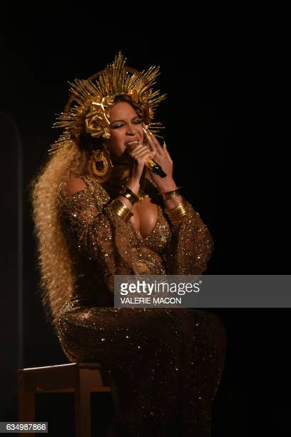 Beyonce performs as she is pregnant with twins during the 59th Annual Grammy music Awards on February 12 in Los Angeles California / AFP / VALERIE...