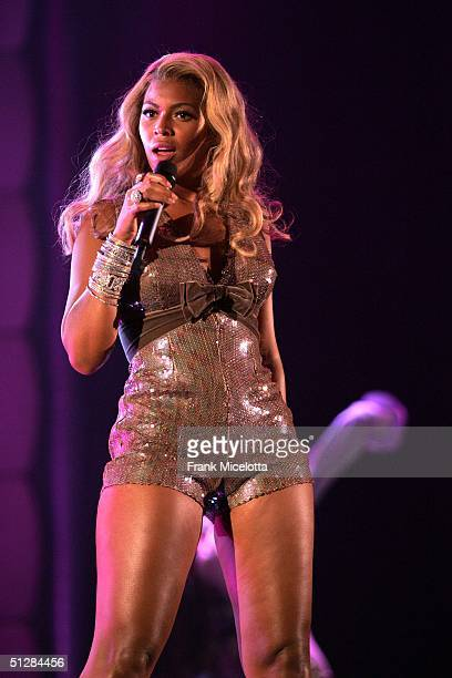 """Beyonce performs on stage at the """"Fashion Rocks"""" concert held at Radio City Music Hall on September 8, 2004 in New York City."""