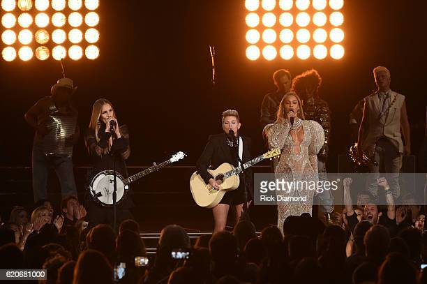 Beyonce performs onstage with Emily Robison and Natalie Maines of Dixie Chicks at the 50th annual CMA Awards at the Bridgestone Arena on November 2...