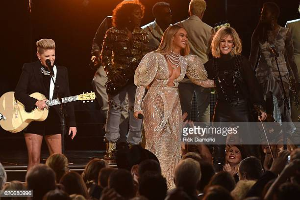 Beyonce performs onstage with Martie Maguire of Dixie Chicks at the 50th annual CMA Awards at the Bridgestone Arena on November 2 2016 in Nashville...