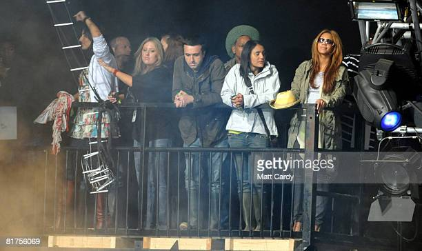 Beyonce watches as JayZ performs on the Pyramid Stage at the Glastonbury Festival at Worthy Farm Pilton on June 28 2008 in Glastonbury Somerset...