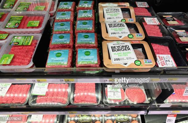 Beyond Meat Beyond Burger patties made from plantbased substitutes for meat products sit alongside various packages of ground beef for sale on...