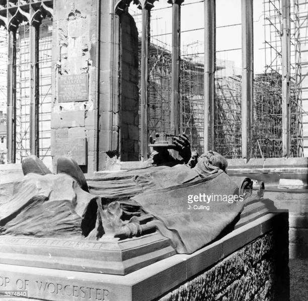 Beyond the ruins of the 15th century Coventry Cathedral gutted by bombing in World War II the construction of the new cathedral church of St Michael...