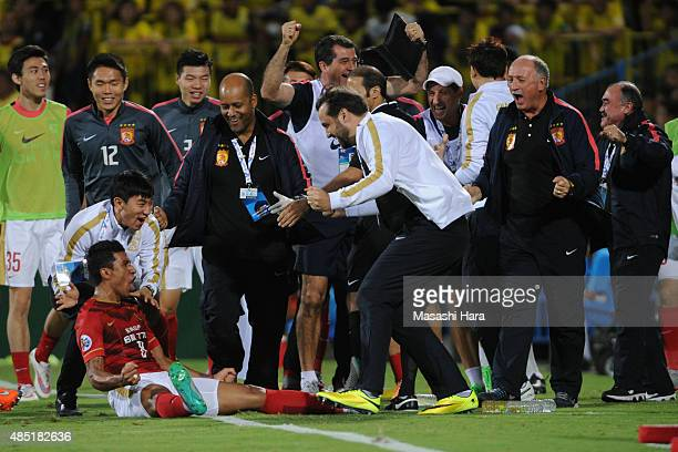 Bezerra Maciel Junior of Guangzhou Evergrande celebrates the second goal during the AFC Champions League quarter final match between Kashiwa Reysol...