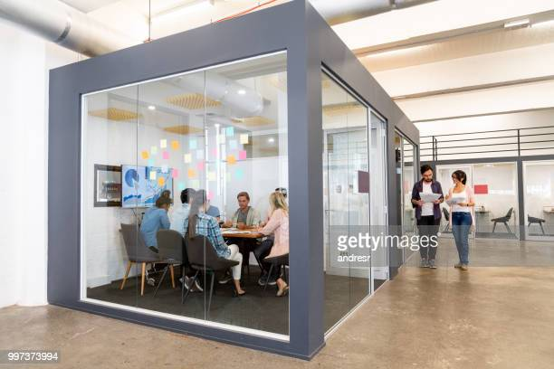 bgroup of people in a business meeting at a creative office - board room stock pictures, royalty-free photos & images