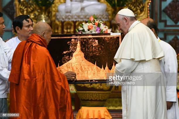 Bhaddanta Kumarabhivasma Chairman of state Sanga Maha Nayaka Committee presents a gift to Pope Francis during their meeting in Yangon on November 29...