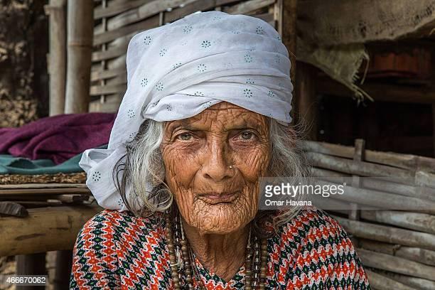 Bhagimaya Neupane 84 years old poses in front of her house in the Beldangi 2 refugee camp on March 14 2015 in Beldangi Nepal Bhagimaya arrived 23...