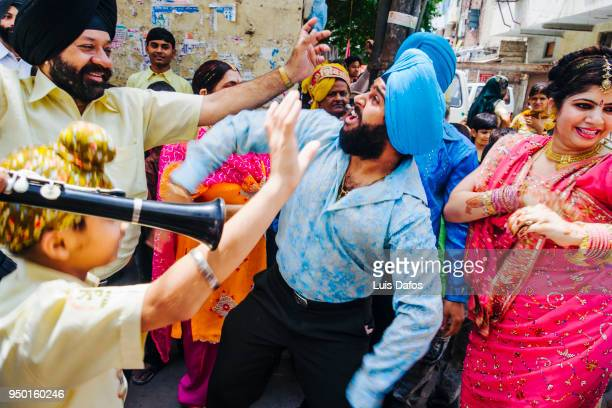 Bhangra dancing at an Indian wedding in the street.