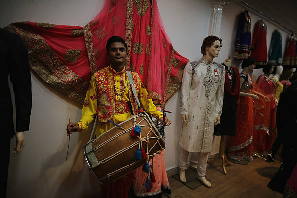 Bhangra drummer enetertains shoppers as people celebrate the Hindu festival of Diwali on November 11 2015 in Leicester United Kingdom Up to 35000...