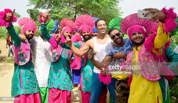 Bhangra team taking a selfie with Bollywood actor Vindu Dara Singh during shooting for Punjabi song on August 11 2017 in Amritsar India