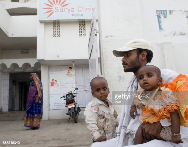 bharat prasad with his two kids of pakari block waiting outside the family planning centre of hazzipur as his wife going for abortion at Surya clinic...