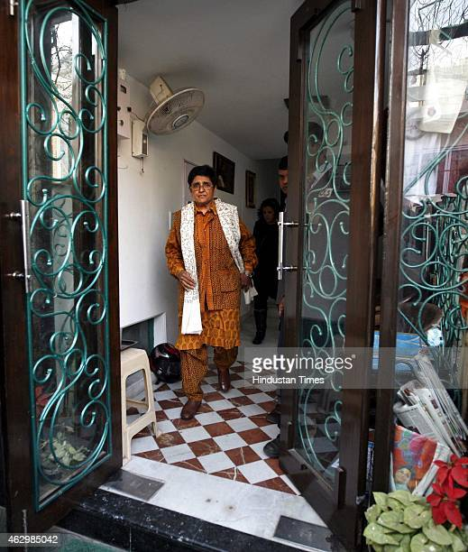 Bharatiya Janata Party chief ministerial candidate Kiran Bedi leaves her residence to attend a BJP poll review meet a day after exit polls predicted...